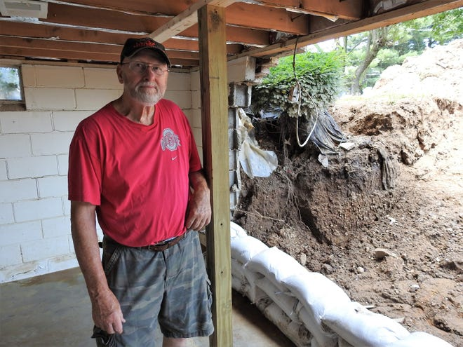 Wilson McCoy's basement wall was destroyed by flash flooding on West Fifth Street in West Lafayette.