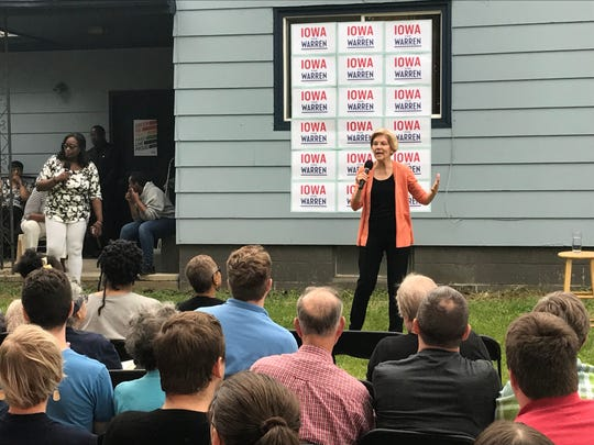 Massachusetts Sen. Elizabeth Warren speaks at a town hall in a resident's backyard in Waterloo on June 9, 2019.