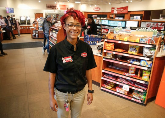 Tee Tee Smith talks about her job at Kum and Go on Keosaqua Way in Des Moines on May 28, 2019.