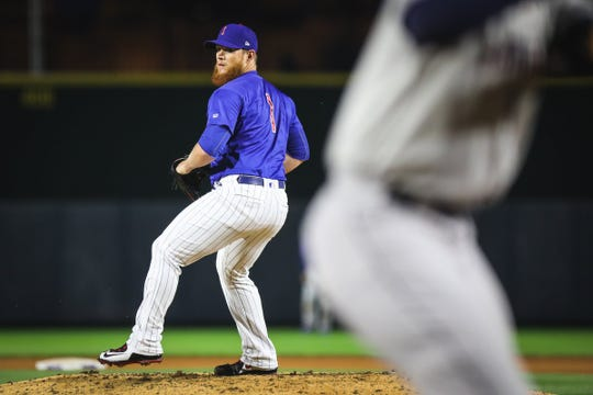 Craig Kimbrel throws a pitch for the Iowa Cubs.