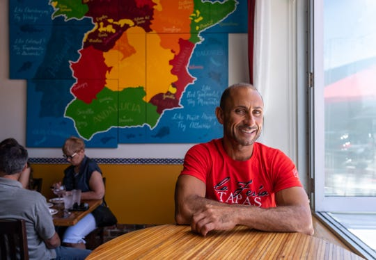 Elias Khalil, co-owner of La Feria Spanish Tapas, is now on the Hatch Detroit board. He's seated at the restaurant in Detroit's Midtown neighborhood on Tuesday, June 25, 2019. Khalil was a winner of the Comerica Hatch Detroit contest in 2012.