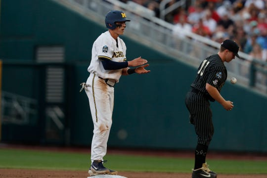 Michigan third baseman Blake Nelson (10) reacts after stealing second base against Vanderbilt shortstop Ethan Paul (10) during the fourth inning in game two of the championship series of the 2019 College World Series at TD Ameritrade Park.