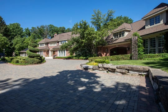 The exterior features a porte-cochere, 6+ car garage and over an acre of professionally landscaped grounds in Bloomfield Hills, Mich., Wednesday, June 26, 2019.