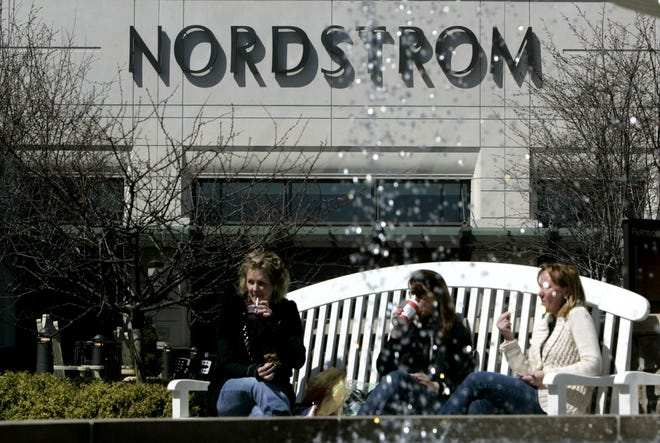 Mall patrons enjoy their lunch in front of the Nordstrom at Partridge Creek a outdoor mall in Clinton Township on Tuesday April 15, 2008. ERIC SEALS/ Detroit Free Press.