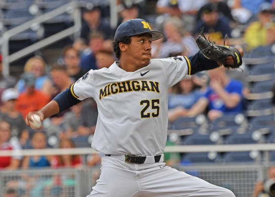 Michigan pitcher Isaiah Paige #25 of the  Michigan Wolverines delivers a pitch in the first inning against the Vanderbilt Commodores during game two of the College World Series Championship Series on June 25, 2019 at TD Ameritrade Park Omaha in Omaha, Nebraska.