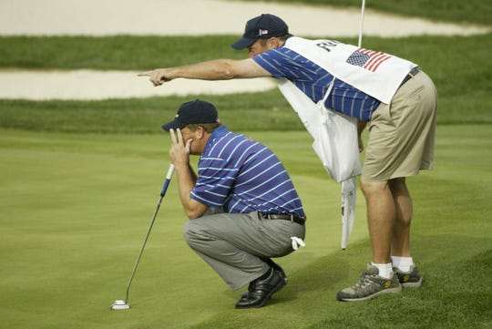 Fred Funk and his caddie Mark Long line up the shot on the 15th hole in the afternoon matches on the first day of the 35th Ryder Cup Matches at the Oakland Hills Country Club in Bloomfield Hills, Michigan, on Friday, September 17, 2004.