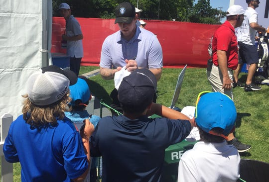 Detroit Red Wings goalie Jimmy Howard signs autographs for young golf fans at the Rocket Mortgage Classic golf tournament at the Detroit Golf Club on Wednesday, June 26, 2019.