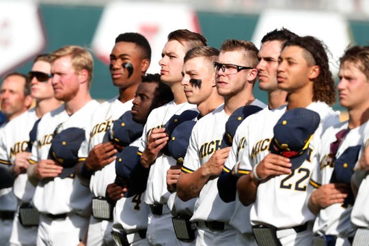 Michigan players stand for the national anthem prior to game two of the championship series of the 2019 College World Series against the Vanderbilt Commodores at TD Ameritrade Park.