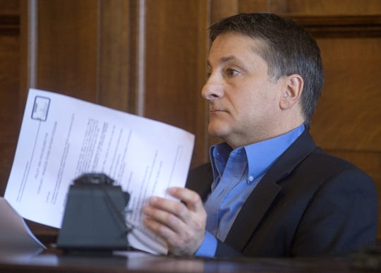 Oakley Police Chief Robert Reznick testifies in Shiawassee County Circuit Court during an evidentiary hearing regarding the Oakley village reserve police force, Wednesday, March 4, 2015, in Corruna, Mich. The hearing is regarding the disclosure of reserve officer names in response to a Freedom of Information Act lawsuit by Owosso resident Brandi Bitterman. She is seeking the names of reserve officers that the village denied.