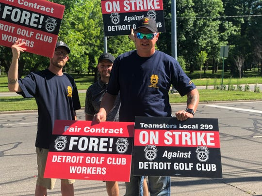 Elery Merrow (center) holds signs at the Teamsters 299 protest outside the Detroit Golf Club on Wednesday June 26, 2019. Greg Levinsky/Detroit Free Press