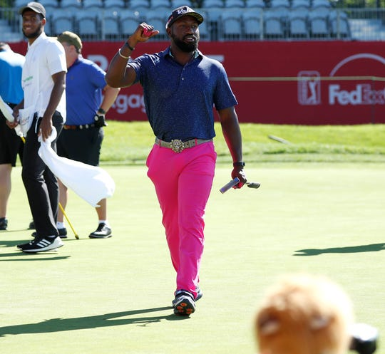 Maurice Allen cheers for his group during the Delta Dental Pro-am at the Rocket Mortgage Classic Wednesday, June 26, 2019 at the Detroit Golf Club.