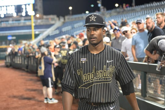 Vanderbilt pitcher Kumar Rocker (80) leaves the field after U-M's 4-1 loss in Game 2 of the College World Series baseball finals in Omaha, Neb., Tuesday, June 25, 2019.