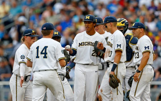 Michigan pitcher Isaiah Paige is pulled in the fifth inning against Vanderbilt in Game 2 of the NCAA College World Series baseball finals in Omaha, Neb., Tuesday, June 25, 2019.