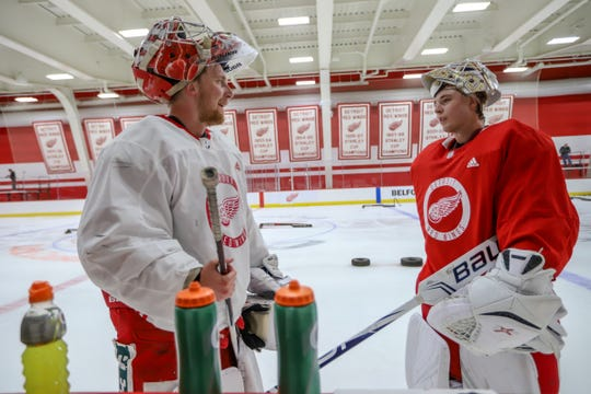 Red Wings goalies Victor Brattstrom (34) and Filip Larsson (38) take a water break during the Detroit Red Wings 2019 development camp at Little Caesars Arena on Wednesday, June 26, 2019.