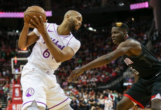 Minnesota Timberwolves' Taj Gibson controls the ball as Houston Rockets' Clint Capela defends at Toyota Center, March 17, 2019.