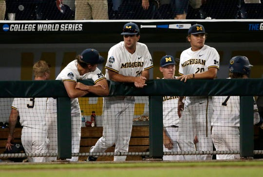 Michigan team members react to their team's 4-1 loss to Vanderbilt in Game 2 of the NCAA College World Series baseball finals Tuesday in Omaha, Neb. The series is tied with the deciding Game 3 scheduled for Wednesday night.