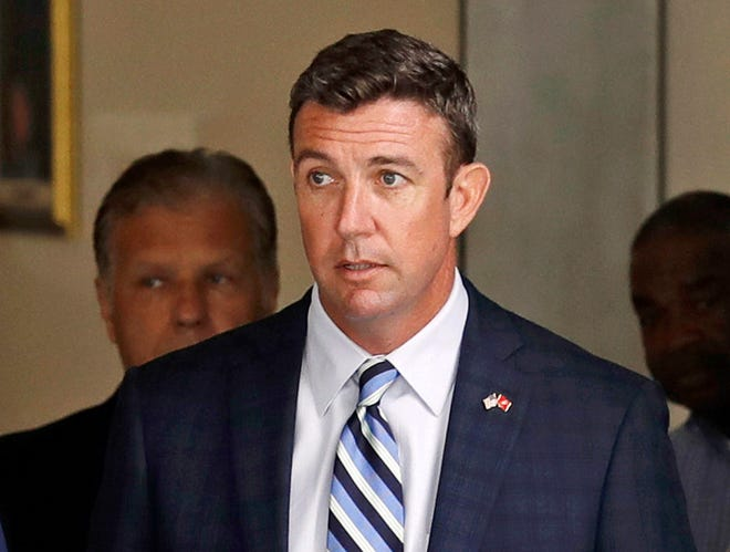 In this Aug. 23, 2018, file photo, Republican U.S. Rep. Duncan Hunter, R-Calif., leaves an arraignment hearing in San Diego after he and his wife, Margaret, pleaded not guilty to charges they illegally used his campaign account for personal expenses.