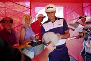 Gary Woodland signs autographs after competing in the pro-am for the Rocket Mortgage Classic on Wednesday.