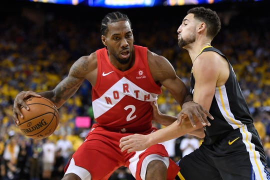 Kawhi Leonard (2), who helped lead the Toronto Raptors to the NBA title, is considered the top player available when free agency begins Sunday, June 30. Klay Thompson (right) also will be a big name on the free-agent market.