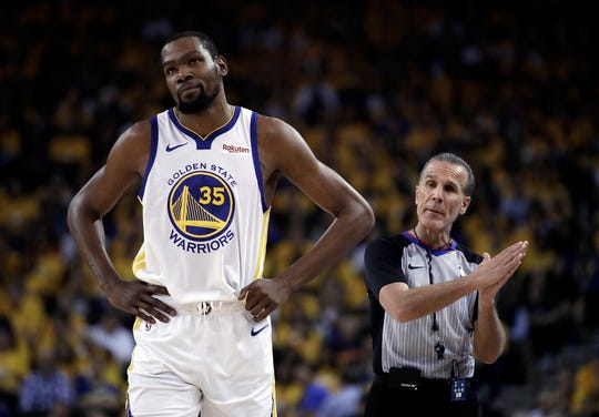 Warriors star Kevin Durant, left, will hit the market as a free agent this summer.