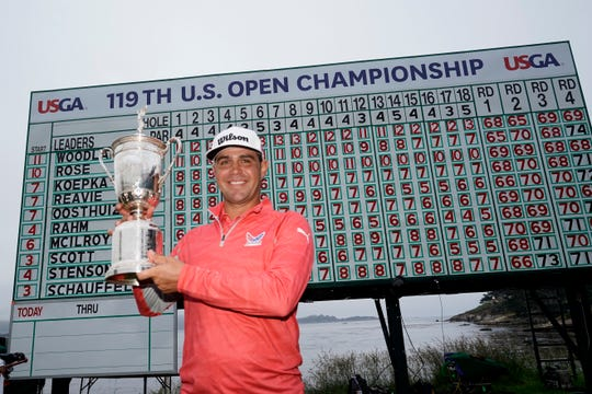Gary Woodland poses with the trophy after winning the U.S. Open.