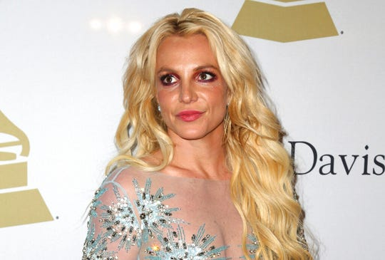 This Feb. 11, 2017 file photo shows Britney Spears at a pre-Grammy gala in Beverly Hills, Calif. The conservatorship that runs Britney Spears' affairs has sued a man who runs a Spears-themed blog for defamation.