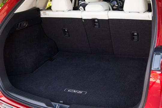 The 2019 CX-5 has 30.9 cubic ft. of cargo space behind the second row, 59.6 cubic ft. with the second row seats folded flat.