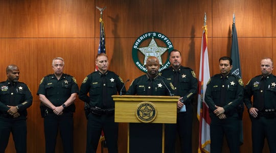 Broward Sheriff Gregory Tony, center, announces that two additional deputies have been fired as a result of the agency's internal affairs investigation into the mass shooting at Marjory Stoneman Douglas High School in Parkland, at the Broward Sheriff's Office headquarters in Fort Lauderdale, Fla., Wednesday, June 26.
