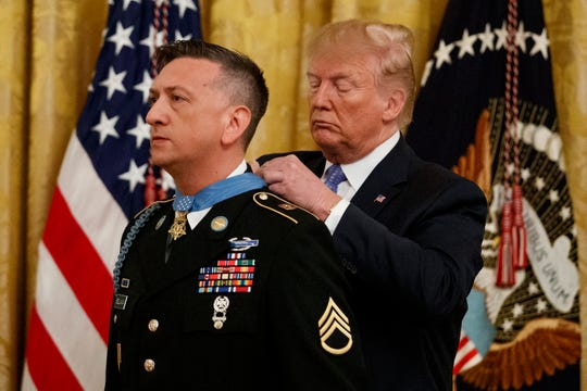 President Donald Trump awards the Medal of Honor to Army Staff Sgt. David Bellavia in the East Room of the White House in Washington, Tuesday, June 25, 2019.