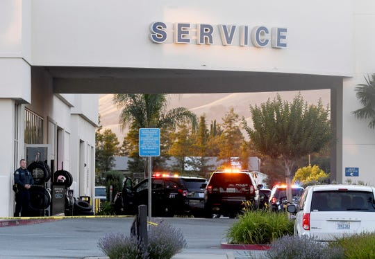 Police investigate at the scene of a shooting at the Morgan Hill Ford Store in Morgan Hill, Calif., Tuesday, June 25, 2019.