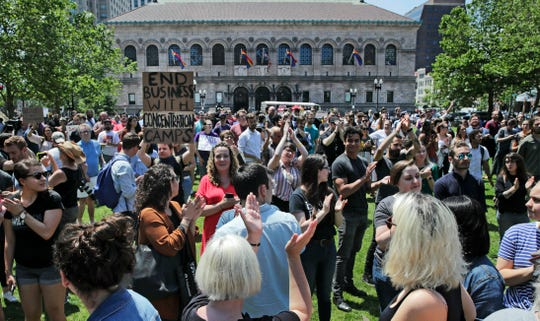 Wayfair employees and supporters rally at Copley Square in Boston.