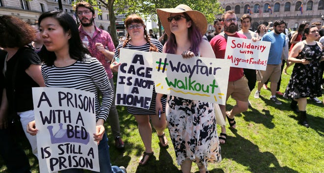 Employees of Wayfair march to Copley Square in protest prior to their rally in Boston.