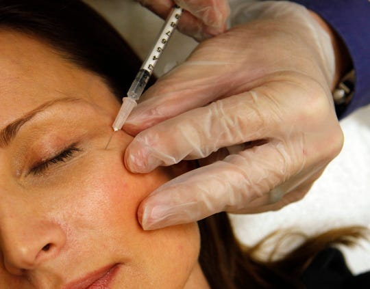 In this June 5, 2009, photo a woman has Botox injected at Reveal in Arlington, Va.