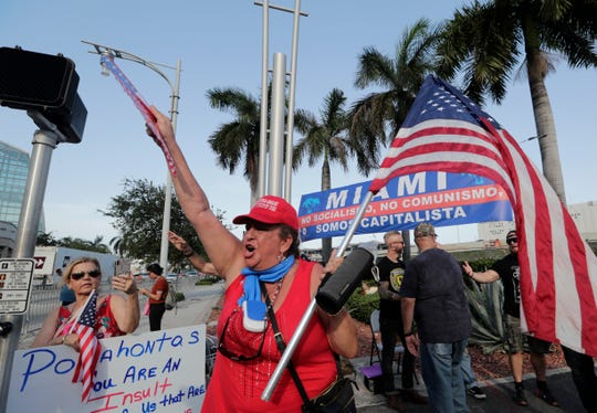 Roxanna Greene, a supporter of President Donald Trump, protests outside of the Knight Concert Hall.