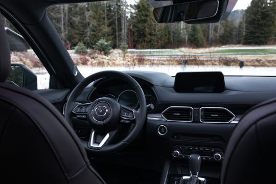 The 2019 Mazda CX-5 features a new auto-dimming rearview frameless mirror with Homelink and genuine layered wood trim on the dash.