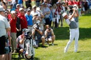 Rickie Fowler hits his second shot on the 18th hole during pro-am of the Rocket Mortgage Classic on Wednesday.