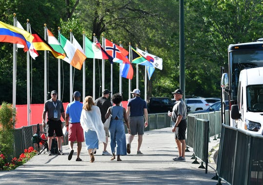 People exit the shuttle buses at the Detroit Golf Club Thursday for the Pro-Am tournament of the Rock Mortgage Classic. So far, transportation is running smoothly.
