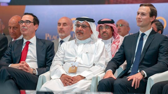 "In this Tuesday, June 25, 2019, photo released by Bahrain News Agency, from left to right, U.S. Treasury Secretary Steven Mnuchin, Bahrain Crown Prince Salman bin Hamad Al Khalifa and White House senior adviser Jared Kushner attend the opening session of the ""Peace to Prosperity"" workshop in Manama, Bahrain."
