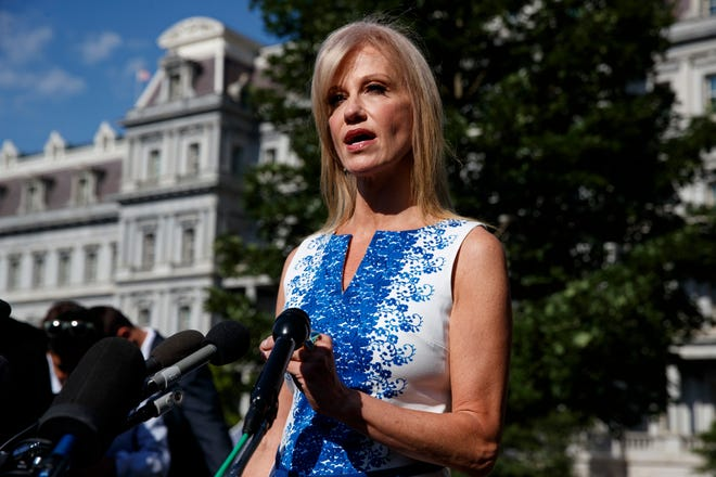 White House counselor Kellyanne Conway talks to reporters outside the White House.