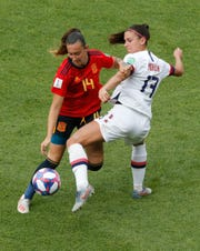 Spain's Virginia Torrecilla, left, challenges Alex Morgan of the U.S. Morgan said Monday's win gave a hint of what to expect from France.