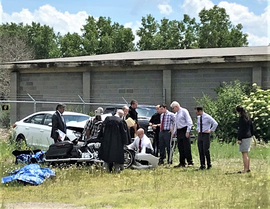 The judge and attorneys in the Caden Charnetski vehicular manslaughter trial look at the wreckage of the car and motorcycle involved in last July's fatal crash.