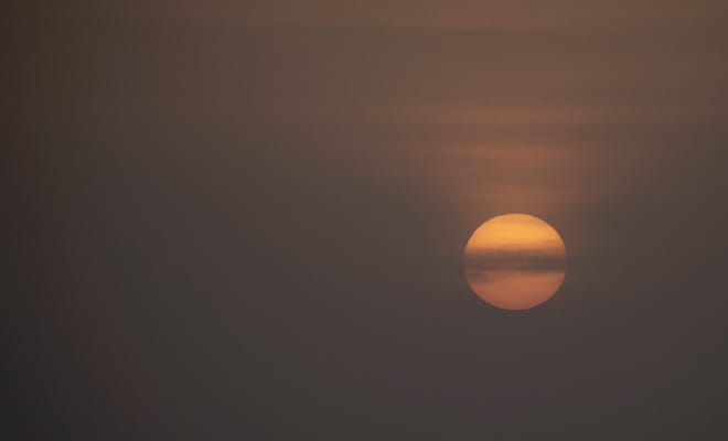 The sunset seen from Lee County had an otherworldly look Tuesday. Dust from the Sahara desert drifted over the Atlantic Ocean and the Gulf of Mexico, causing hazy conditions.