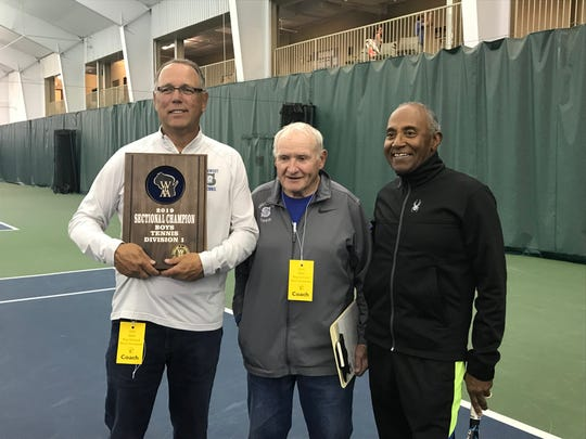 Green Bay Southwest tennis coach Randy Nelson, left, poses with assistant coaches Bill Simon, center, and Windsor Tanner.