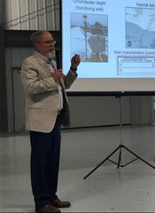 Mark Borchardt, research microbiologist with the U.S. Department of Agriculture, gives a public presentation on factors that can cause a risk of contamination of private water wells in Kewaunee County June 20 at the county fairgrounds Exposition Hall.