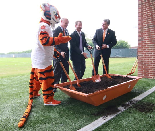 Tiger mascot (left), Jim Clements, Dabo Swinney, and Dan Radakovich during a groundbreaking ceremony for a new Indoor Football Facility. The $55 million project is expected to open in Feburary 2017.
