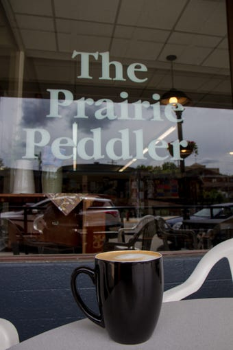 Salted caramel chai tea latte with almond milk in front of the Prairie Peddler