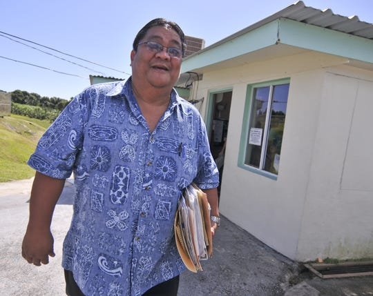 In this December 2010 file photo, John Mantanona of the Guam Police Department prepares to depart from visitation processing center at the Department of Corrections after executing a search warrant a