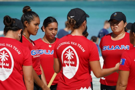 Thec Guam women's team talk strategy at the MPRA Galaide Cup Series 1 June 22.