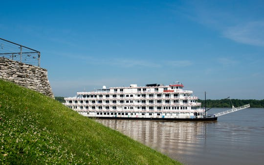 The Queen of the Mississippi peaks out from below Audubon Mill Park as it prepares to dock in Downtown Henderson Wednesday morning. It was scheduled to arrive Thursday morning, but showed up early.