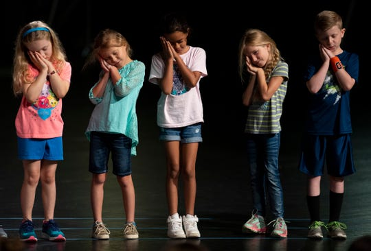 "Young actors rehearse a scene from ""Beauty and the Beast"" at the Preston Arts Center Tuesday morning. They were attending a youth drama camp to prepare for a Saturday performance of the play at 3 p.m."